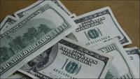 Rotating stock footage shot of $100 bills - MONEY 0148