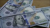 Rotating stock footage shot of $100 bills - MONEY 0144