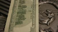 Rotating stock footage shot of American paper currency on an American eagle shield background - MONEY 0388