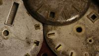 Rotating stock footage shot of antique and weathered watch faces - WATCH FACES 007