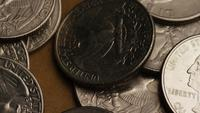 Rotating stock footage shot of American quarters (coin - $0.25) - MONEY 0229