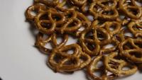 Rotating shot of Pretzels on a white plate - PRETZELS 006