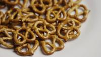 Rotating shot of Pretzels on a white plate - PRETZELS 003