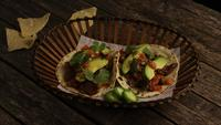 Rotating shot of delicious tacos on a wooden surface - BBQ 135