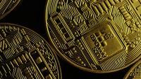 Rotating shot of Bitcoins (digital cryptocurrency) - BITCOIN 0055
