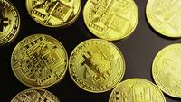 Rotating shot of Bitcoins (digital cryptocurrency) - BITCOIN 0076