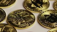 Rotating shot of Bitcoins (digital cryptocurrency) - BITCOIN 0160