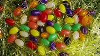 Rotating shot of Easter decorations and candy in colorful Easter grass - EASTER 009