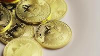 Rotating shot of Bitcoins (digital cryptocurrency) - BITCOIN 0169
