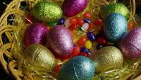 Rotating shot of Easter decorations and candy in colorful Easter grass - EASTER 020