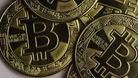 Rotating shot of Bitcoins (digital cryptocurrency) - BITCOIN 0291