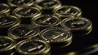 Rotating shot of Bitcoins (digital cryptocurrency) - BITCOIN LITECOIN 218