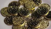 Rotating shot of Bitcoins (digital cryptocurrency) - BITCOIN 0389