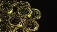Rotating shot of Bitcoins (digital cryptocurrency) - BITCOIN 0543