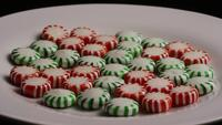Rotating shot of spearmint hard candies - CANDY SPEARMINT 069