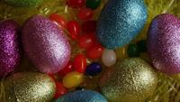 Rotating shot of Easter decorations and candy in colorful Easter grass - EASTER 013