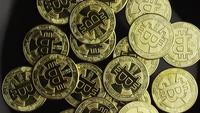 Rotating shot of Bitcoins (digital cryptocurrency) - BITCOIN 0530