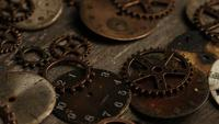 Rotating stock footage shot of antique and weathered watch faces - WATCH FACES 106
