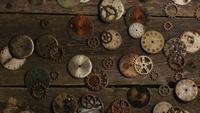 Rotating stock footage shot of antique and weathered watch faces - WATCH FACES 073