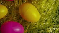 Rotating shot of Easter decorations and candy in colorful Easter grass - EASTER 002