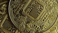 Rotating shot of Bitcoins (digital cryptocurrency) - BITCOIN 0582