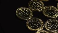 Rotating shot of Bitcoins (digital cryptocurrency) - BITCOIN 0472