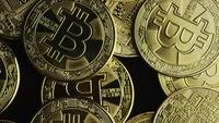 Rotating shot of Bitcoins (digital cryptocurrency) - BITCOIN 0576