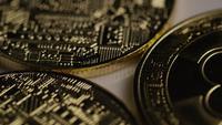 Rotating shot of Bitcoins (digital cryptocurrency) - BITCOIN 0360