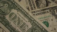 Tiro giratorio del dinero estadounidense (moneda) - DINERO 447