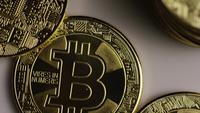 Rotating shot of Bitcoins (digital cryptocurrency) - BITCOIN 0424