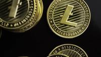 Rotating shot of Bitcoins (digital cryptocurrency) - BITCOIN LITECOIN 345