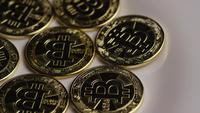 Rotating shot of Bitcoins (digital cryptocurrency) - BITCOIN 0263