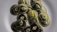 Rotating shot of Ethereum Bitcoins (digital cryptocurrency) - BITCOIN ETHEREUM 0026