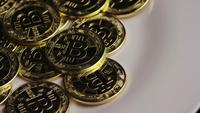 Rotating shot of Bitcoins (digital cryptocurrency) - BITCOIN 0301