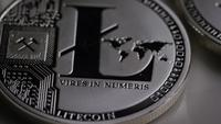 Rotating shot of Litecoin Bitcoins (digital cryptocurrency) - BITCOIN LITECOIN 0139