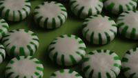 Rotating shot of spearmint hard candies - CANDY SPEARMINT 029