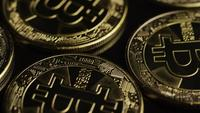 Rotating shot of Bitcoins (digital cryptocurrency) - BITCOIN 0475