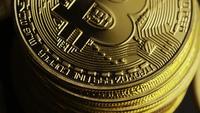 Rotating shot of Bitcoins (digital cryptocurrency) - BITCOIN 0103