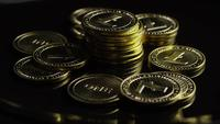 Rotating shot of Bitcoins (digital cryptocurrency) - BITCOIN LITECOIN 356