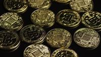 Rotating shot of Bitcoins (digital cryptocurrency) - BITCOIN 0506