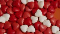 Rotating stock footage shot of Valentines decorations and candies - VALENTINES 0049