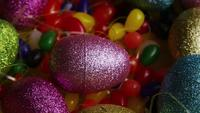 Rotating shot of Easter decorations and candy in colorful Easter grass - EASTER 021