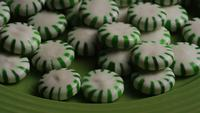 Rotating shot of spearmint hard candies - CANDY SPEARMINT 048