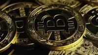 Rotating shot of Bitcoins (digital cryptocurrency) - BITCOIN 0593