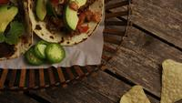 Rotating shot of delicious tacos on a wooden surface - BBQ 133