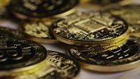 Rotating shot of Bitcoins (digital cryptocurrency) - BITCOIN 0415