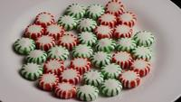 Rotating shot of spearmint hard candies - CANDY SPEARMINT 064