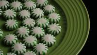 Rotating shot of spearmint hard candies - CANDY SPEARMINT 028