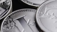 Rotating shot of Bitcoins (digital cryptocurrency) - BITCOIN LITECOIN 488