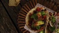 Rotating shot of delicious tacos on a wooden surface - BBQ 145